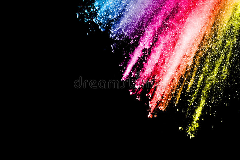 Powder explosion. Closeup of color particle explosion isolated. On black background stock photos
