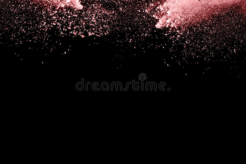 Powder explosion. Closeup of color particle explosion isolated. On black background royalty free stock photos