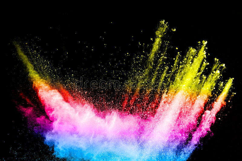Powder explosion. Closeup of color particle explosion isolated. On black background stock photo