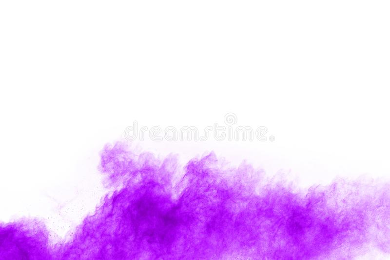 Closeup of a purple dust particle explosion isolated on white background. stock photo