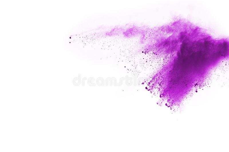 Closeup of a purple dust particle explosion isolated on white background. royalty free stock photo