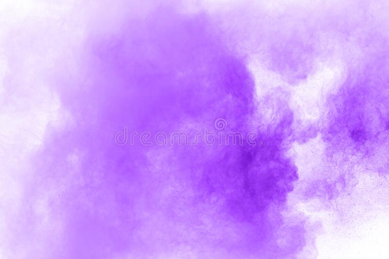 Closeup of a purple dust particle explosion isolated on white. Abstract background. royalty free stock photos