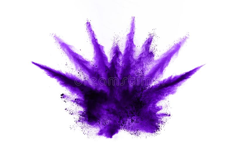 Closeup of a purple dust particle explosion isolated on white. Abstract background. Powder explosion. Closeup of a purple dust particle explosion isolated on stock image