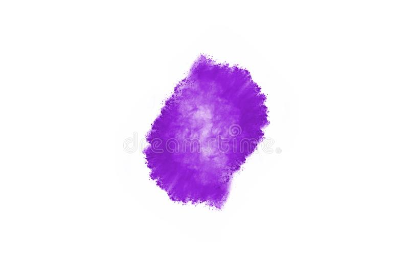 Purple color powder explosion on white background. Powder explosion. Closeup of a purple dust particle explosion isolated on white. Abstract background royalty free stock photos