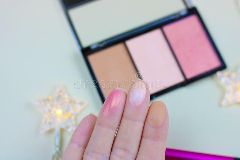 Powder pallet, blush, bronzer. Open powder box with beige powder and pink blush, professional brush. Compact pallet of bronzer and blush royalty free stock photography