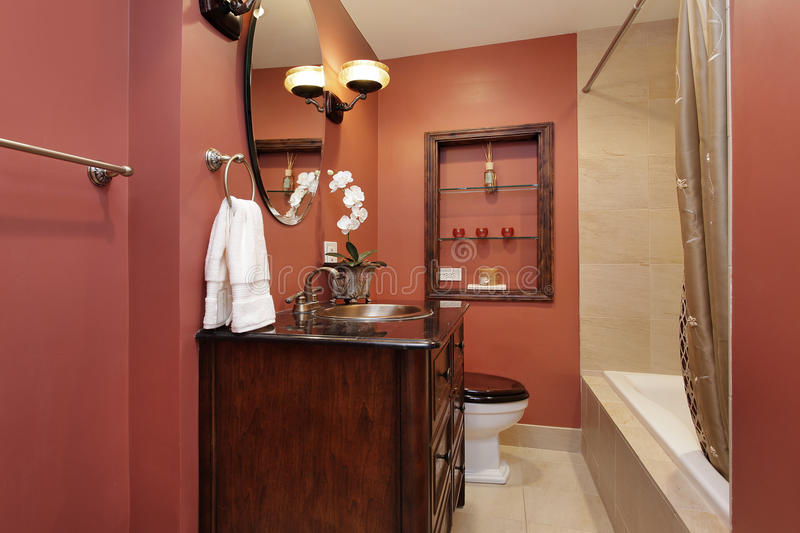 Powder room in luxury home. With salmon-covered walls stock images