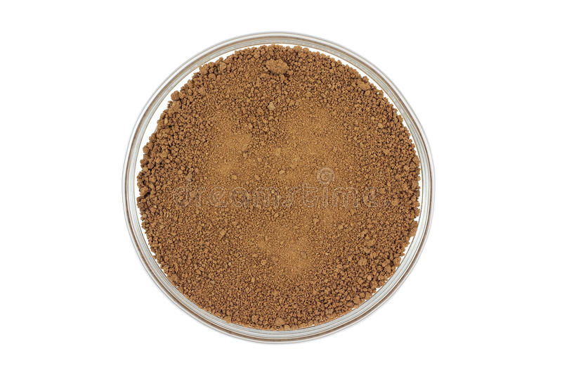 Powder soluble cocoa in a glass cup. On a white background stock image