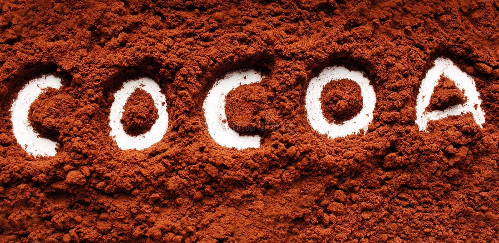 Powder written cocoa. The word cocoa written in cocoa powder royalty free stock photo