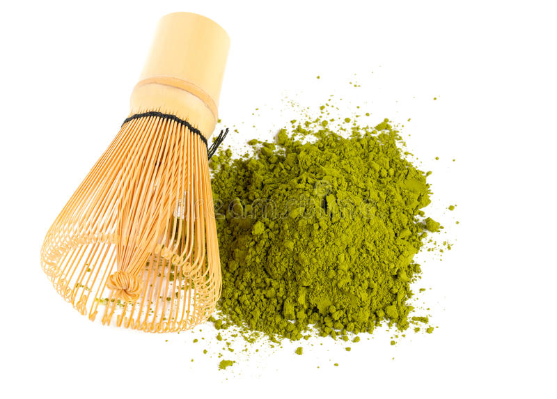 Powdered green tea Matcha and bamboo whisk. On white royalty free stock photography