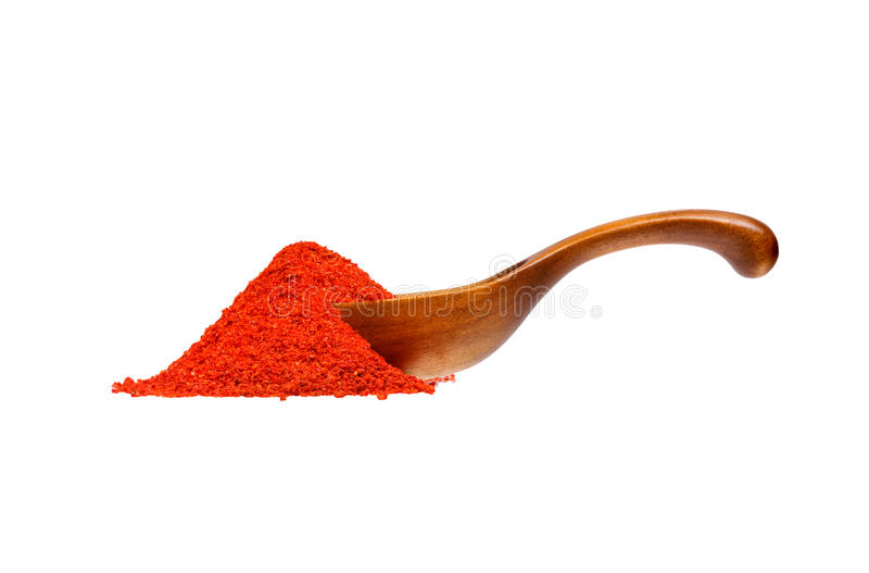 Powdered pimienta roja red pepper in the wooden spoon. stock photography