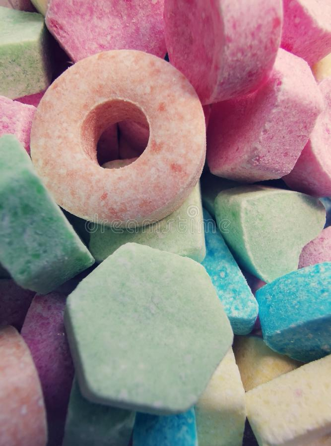 Powdered sweets, sugar candy background - group of colorful dessert.  stock photography