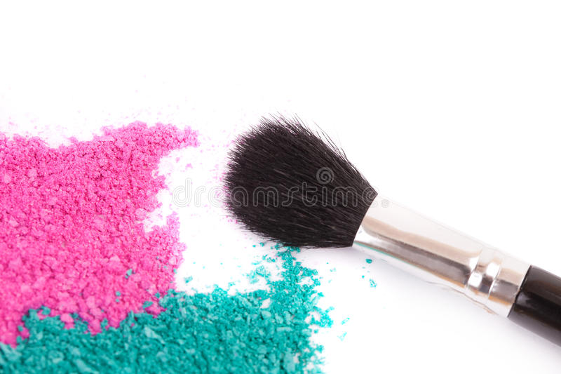 Powdery eyeshadow makeup and brush. On a white background royalty free stock image