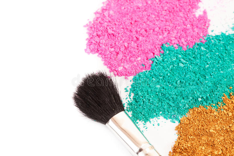 Powdery eyeshadow makeup and brush. On a white background royalty free stock photo