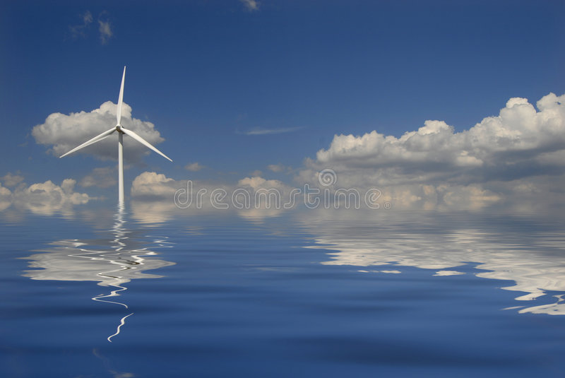 Power. Modern white wind turbine or wind mill producing energy stock image