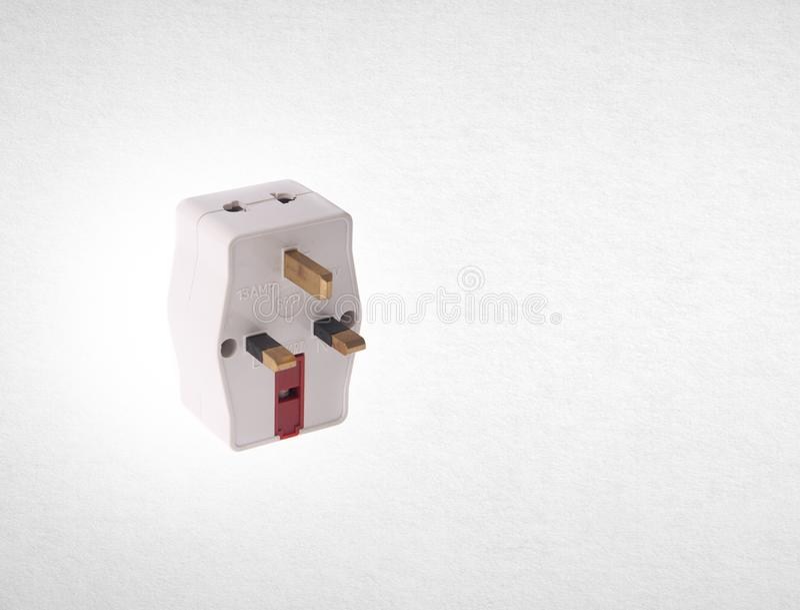 Power Adaptor or UK Power Adaptor on the background. Power Adaptor or UK Power Adaptor on the background stock photo