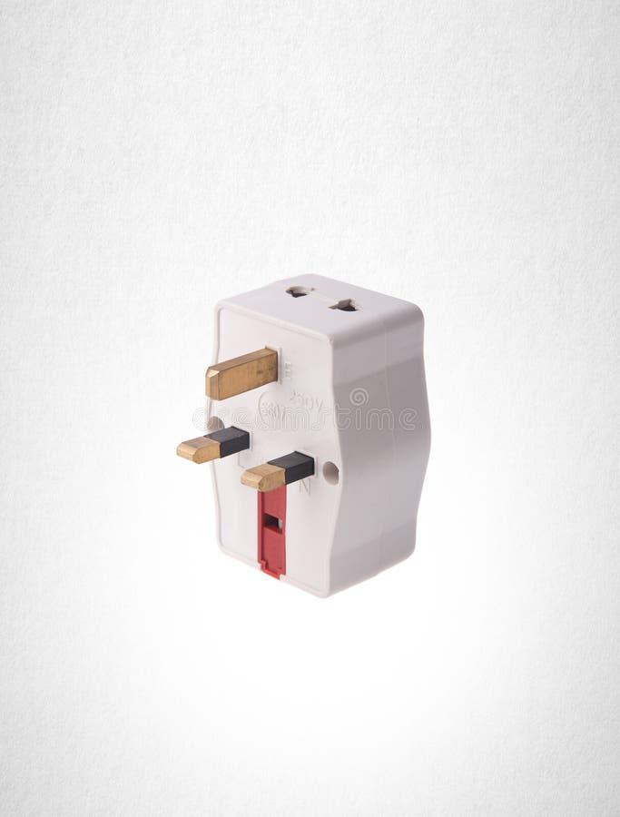 Power Adaptor or UK Power Adaptor on the background. Power Adaptor or UK Power Adaptor on the background royalty free stock photo