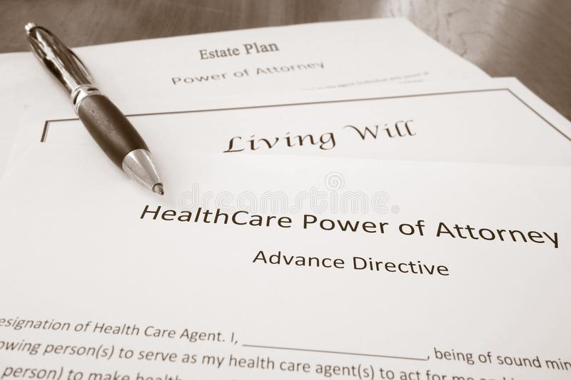 Power of attorney, estate plan and living will. Healthcare Power of Attorney, Living Will document, and Estate Plan royalty free stock photo