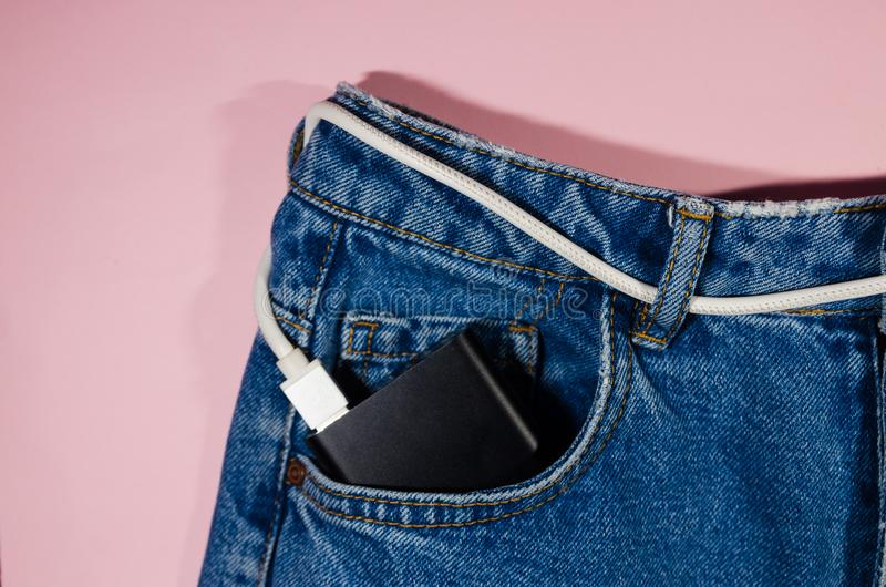 Power bank in jeans royalty free stock photos