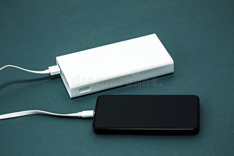 Power bank and mobile phone stock images