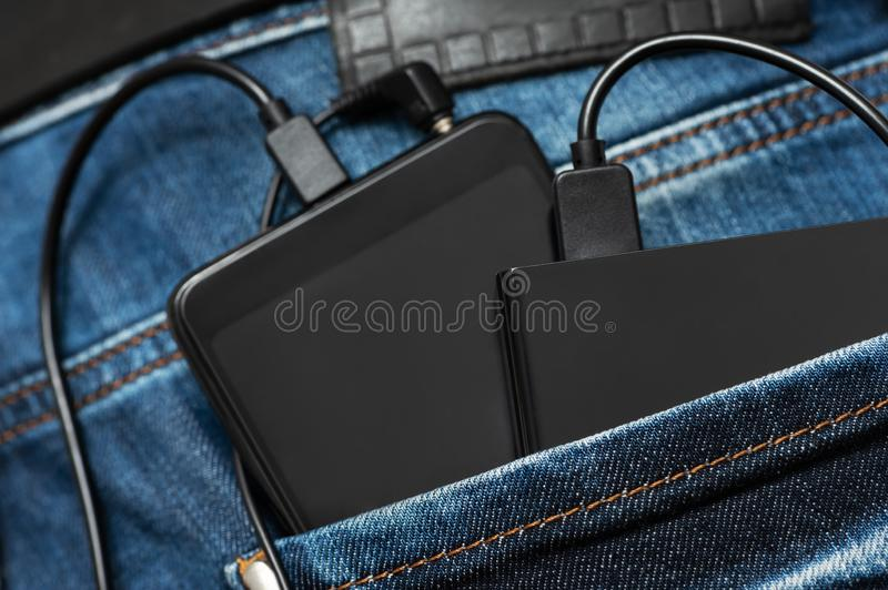 Power bank and smartphone stock photography