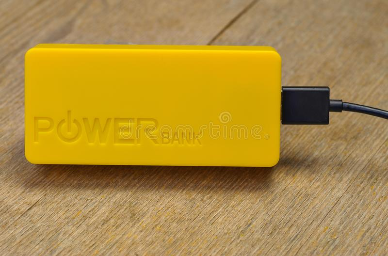 Power Bank with USB cable. Accumulator charging. External battery stock images
