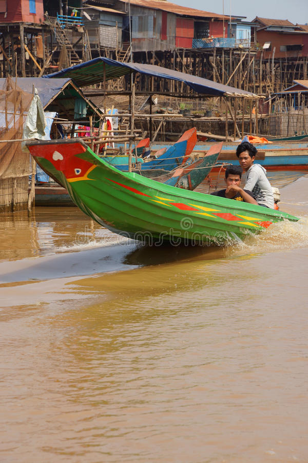 Power boat travels waterway. KOMPONG KLEANG, CAMBODIA - FEB 12, 2015 - Power boat travels along the waterway of Kompong Kleang floating fishing village, Cambodia stock images