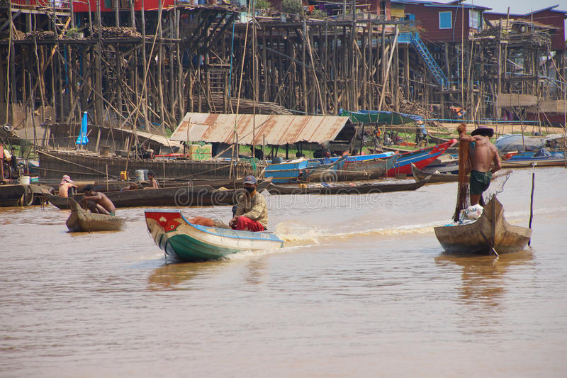 Power boat travels waterway. KOMPONG KLEANG, CAMBODIA - FEB 12, 2015 - Power boat travels along the waterway of Kompong Kleang floating fishing village, Cambodia stock photos