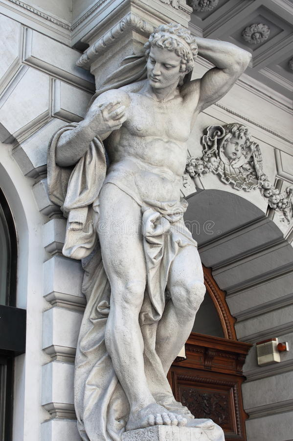 Power. Brawny statue supporting a column on a renaissance palace. Metaphor of power stock image