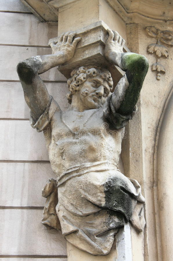 Power. Brawny statue supporting a column on a renaissance palace. Metaphor of power royalty free stock photos