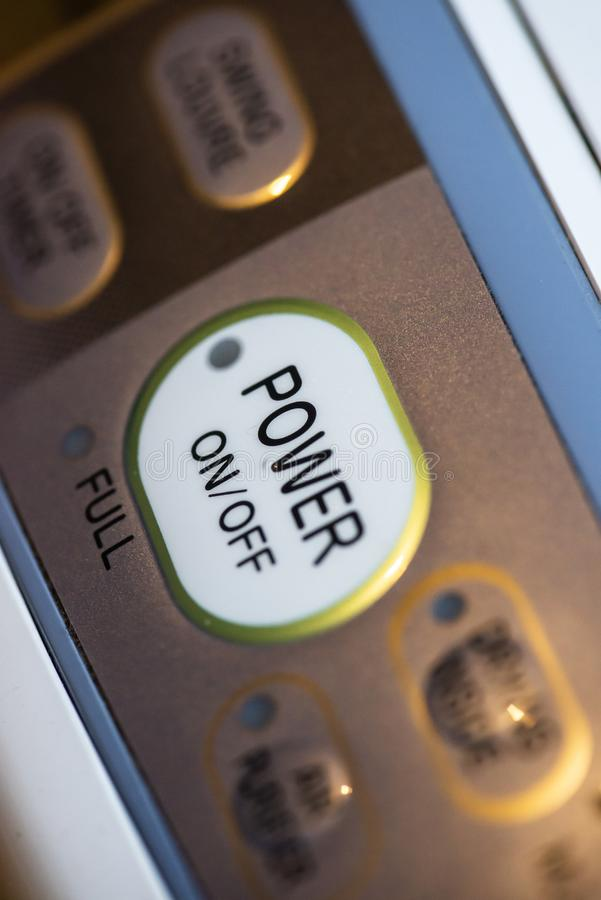 Power on button on electrical device. Close up button stock photography