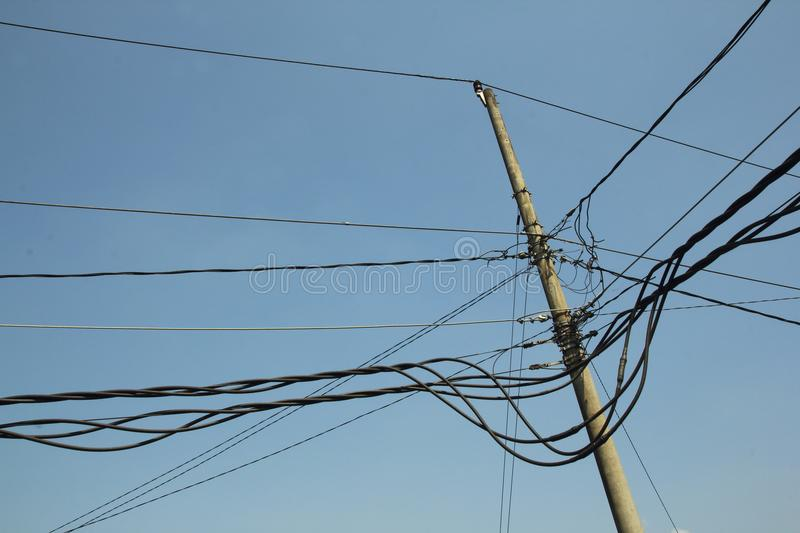Power cables are chaotic. Chaotic power cables are not safe for safety and trigger a fire royalty free stock image