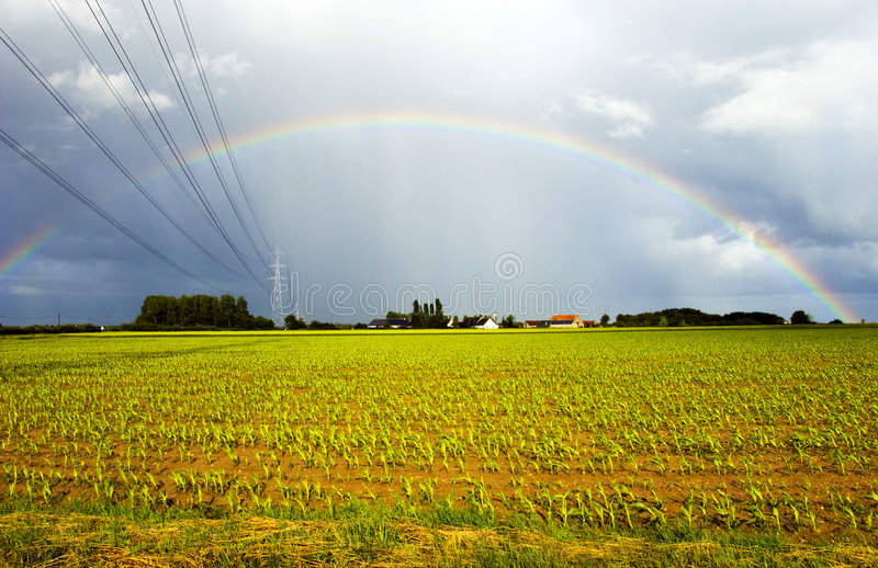 Power cables entering rainbow stock images