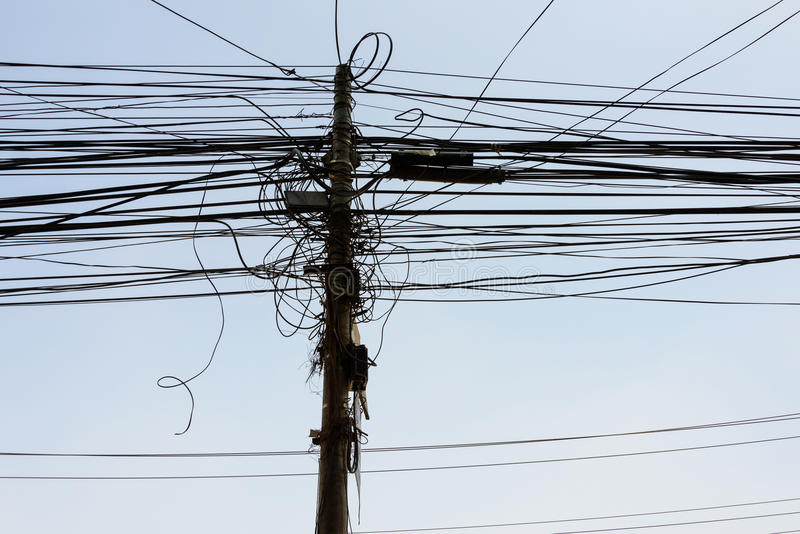 Power cables in Kathmandu. Power cables and pole in Kathmandu, Nepal royalty free stock image