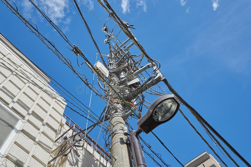 Many electric cables. Power and communication lines in a town stock photo
