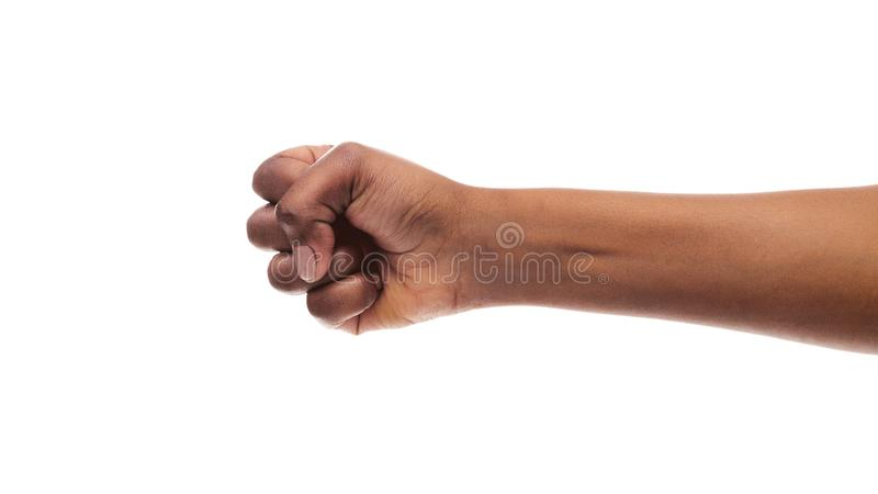 Clenched fist of african american female isolated on white background. Power concept. Black woman`s hand with clenched fist, fight gesture, ready to punch royalty free stock photos