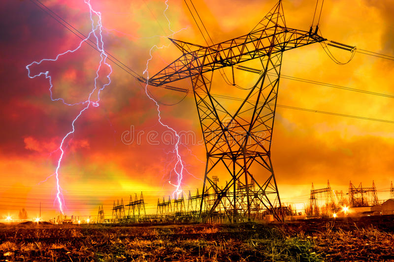 Power Distribution Station with Lightning Strike. royalty free stock photography