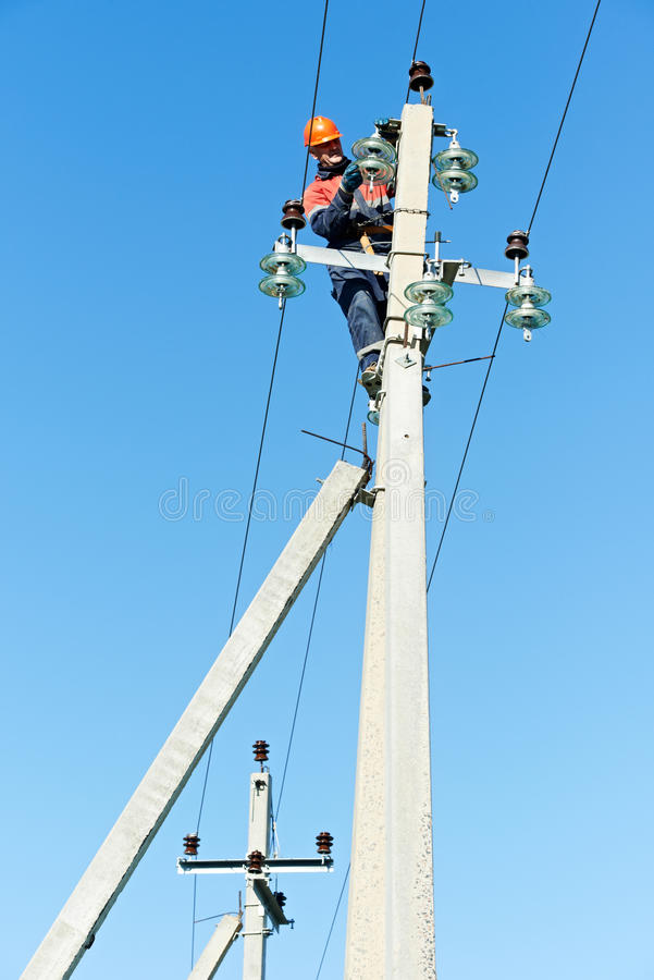 Power Electrician Lineman At Work On Pole Stock Photos