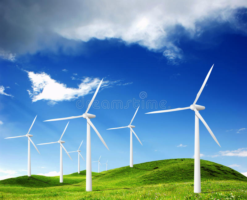 Power generating windmills stock photo