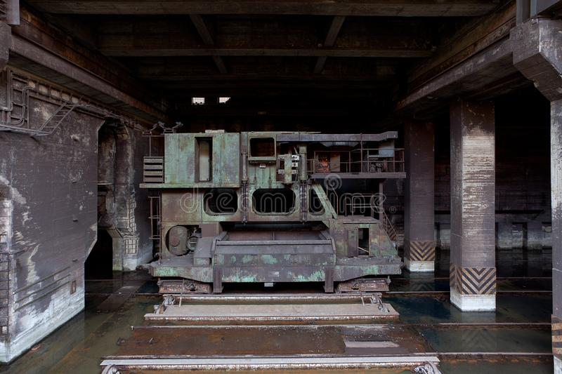 Power generator industrial lift Landschaftspark, Duisburg, Germany. Electric power generator and vintage industrial transfer lift at an old and abandoned iron stock photography