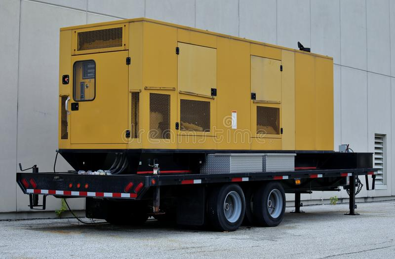 Power generator. Portable power generator sits on a trailer ready for emergency use when disaster hits stock photography