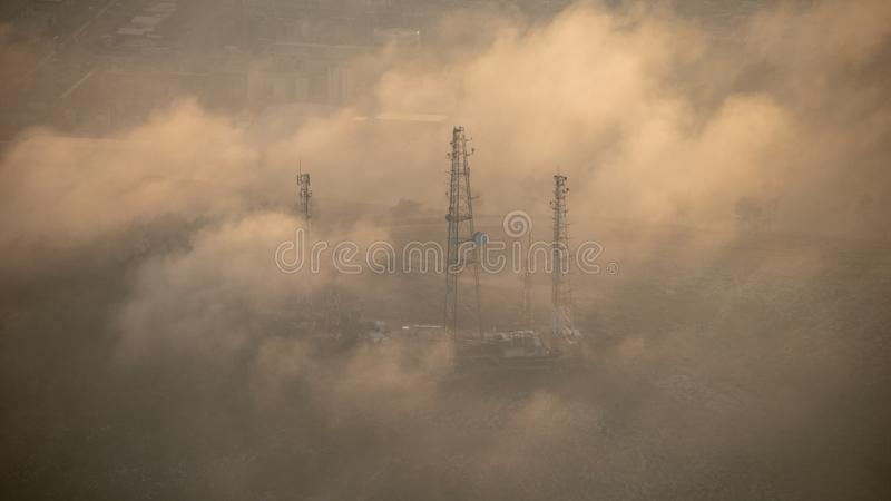 Power grid hidden in the clouds royalty free stock image