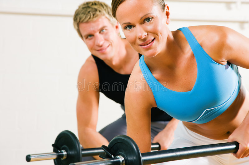 Power gymnastics with barbells stock images