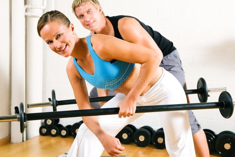 Power gymnastics with barbells stock photo