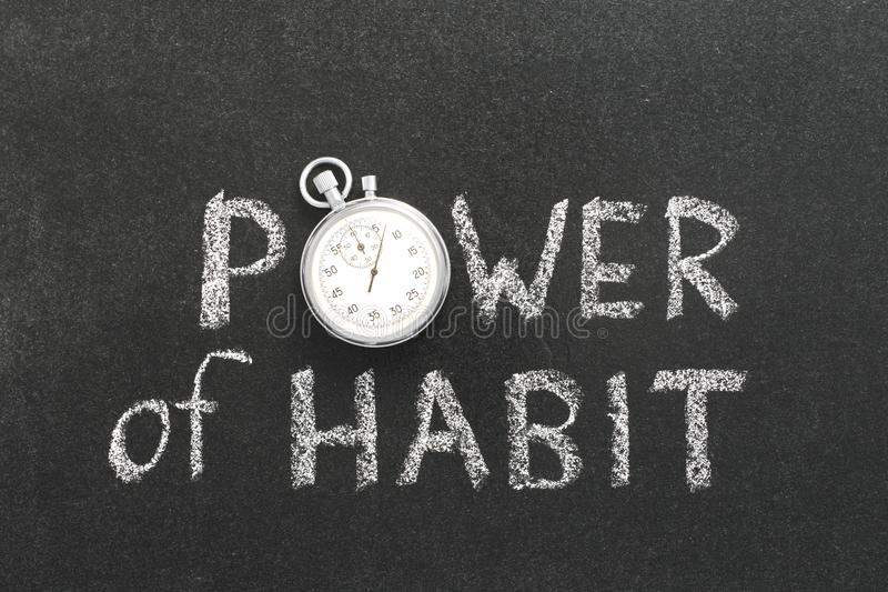 Power of habit watch. Power of habit phrase handwritten on chalkboard with vintage precise stopwatch used instead of O stock photo