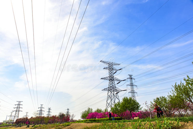 Power installations under the blue sky and white clouds stock photography