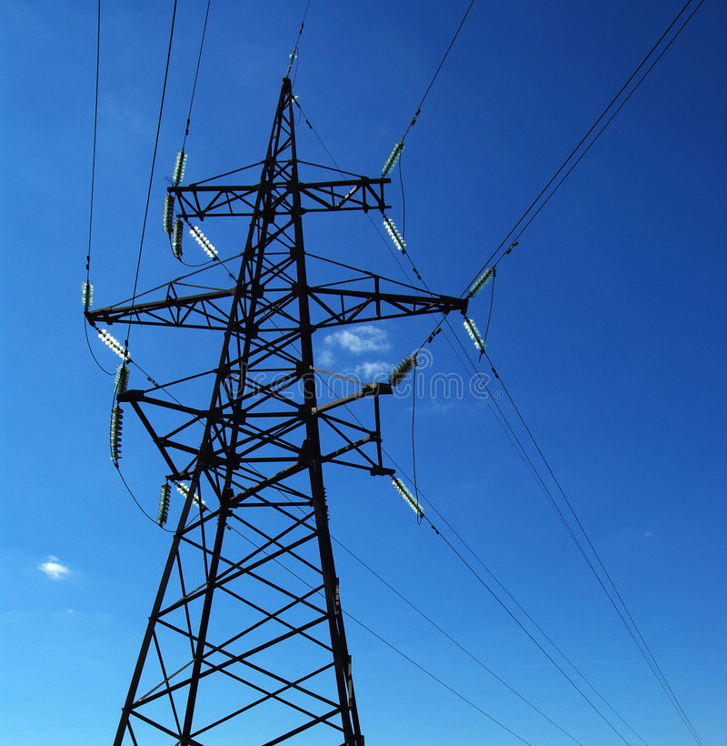 Power line. There's a power line on a clear blue sky royalty free stock image