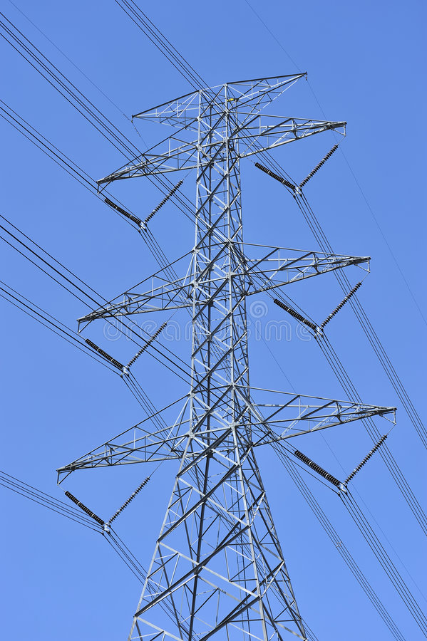 Power line and electricity pylon. Three-phase electric power systems are used for high and extra-high voltage AC transmission lines (50 kV and above). The towers stock photos
