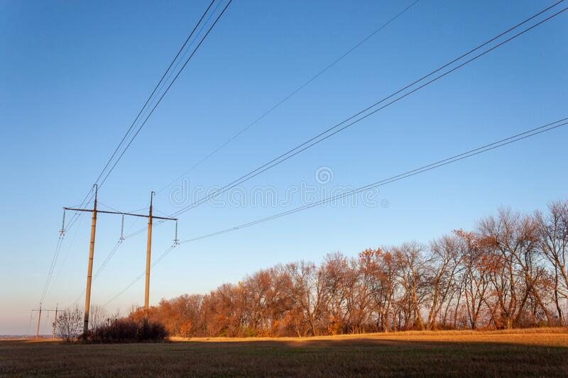 Power line landscape in a field on a clear day royalty free stock images