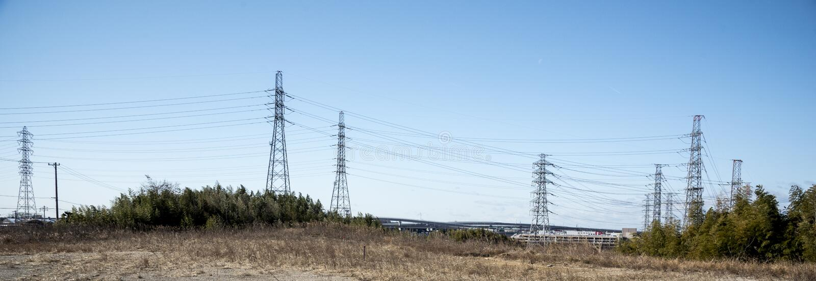 Power line in nature and sky, landscape, Technology concept stock photo