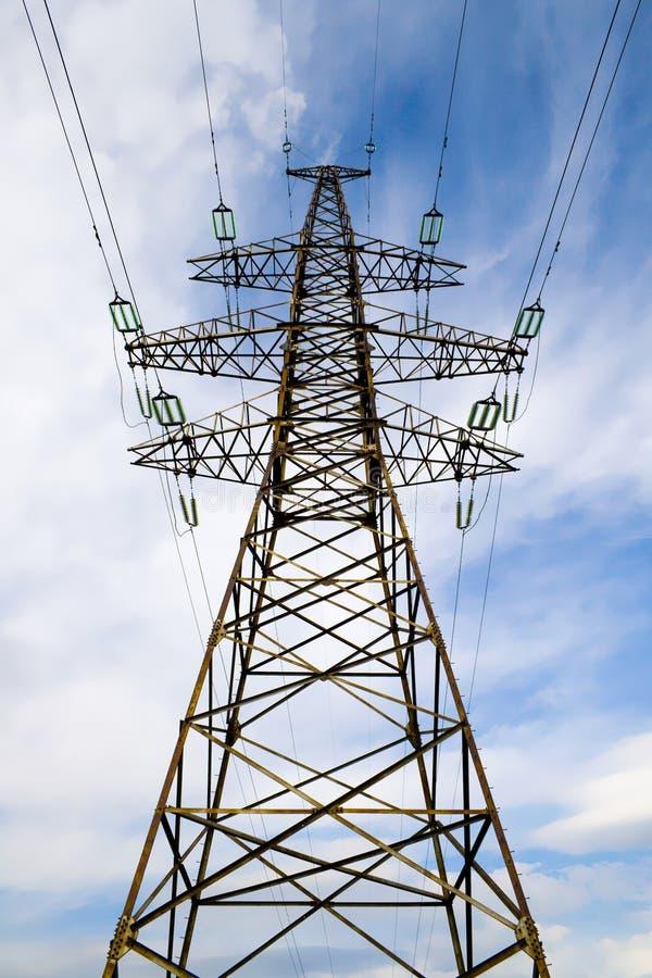 Power line pillar against sky stock photos